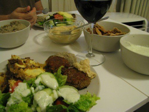 tzatziki sauce over salad