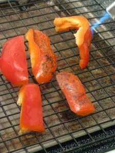 blow torching red peppers