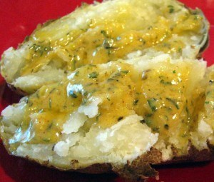 butter sauce over baked potato
