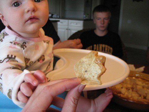 baby eats dip